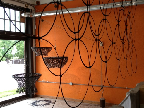 "Alysia Fischer ""Suspended Resources"" - Installation view with award winning bike tire screen"